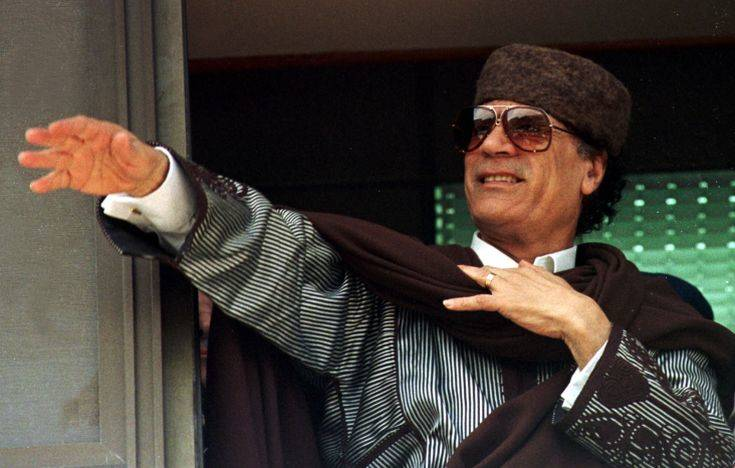 Libyan President Moammar Gaddafi acknowledges a crowd that gathered outside the governor's office to greet him in Marsa Matruh, Egypt, about 400 km (250 miles) northwest of Cairo Friday, March 5, 1999. Gaddafi will meet Egyptian President Hosni Mubarak on the proposed hand-over of the Lockerbie bombing suspects for trial. Gaddafi has long refused to turn over the suspects, who have been indicted in Scotland and the United States, for the blowing up of an American airliner over the Scottish town of Lockerbie in 1988. The bombing killed 270 people, mainly Britons and Americans. (AP Photo/Enric Marti)